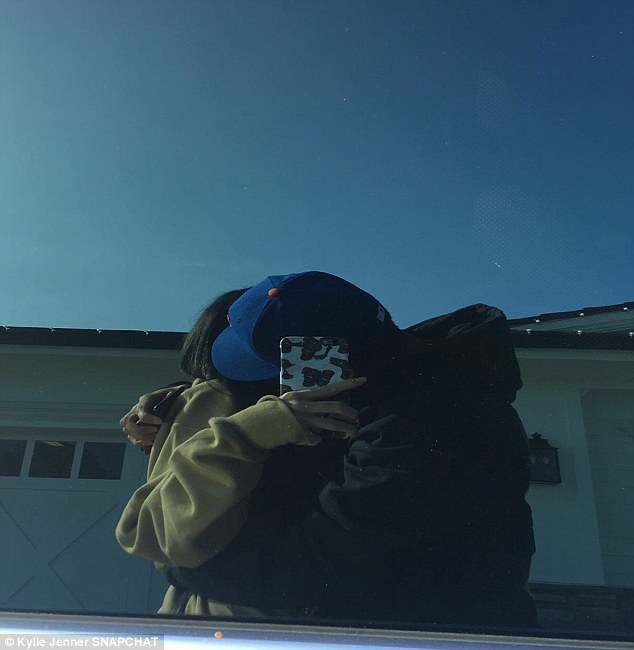 Inseparable: The duo had a smooch as Kylie caught the moment in the reflection of her car