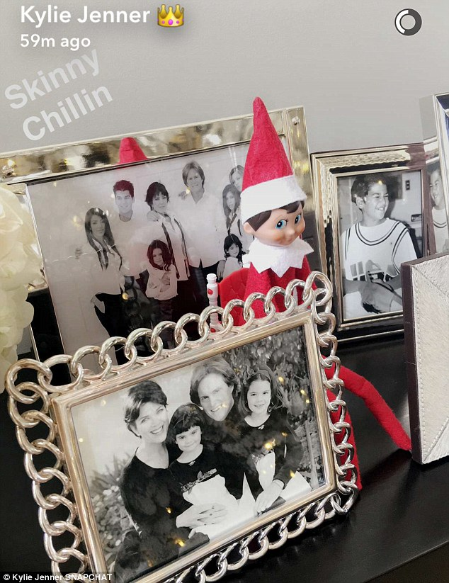 Delightful decor: Another Snapchat showed a shelf with family photos and red elves