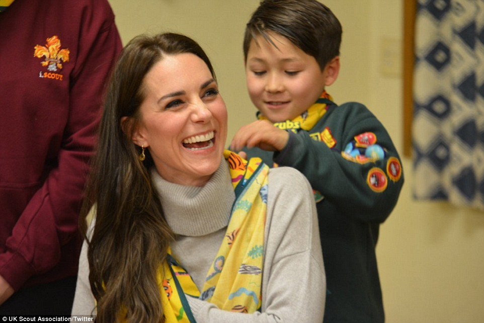 The Duchess is given a helping hand by a youngster who shows her how to fashion her woggle into a sling at Wednesday night'sCub Scout Pack meeting with youngsters from the Kings Lynn District on Wednesday night to celebrate 100 years