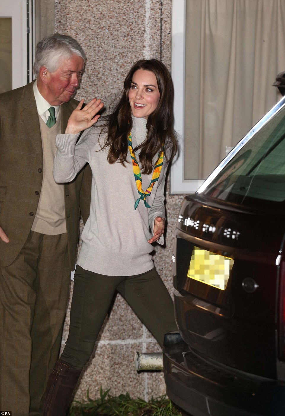 Bye for now! The Duchess, a former Brownies member, gets into a waiting car at the end of her visit in King's Lynn