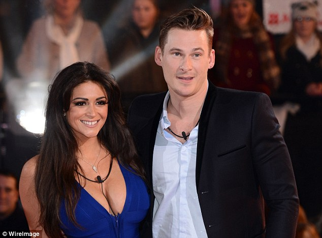 Casey's breasts were a size GG when she appeared in Celebrity Big Brother alongside Blue singer Lee Ryan (right)
