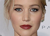 Jennifer shines in strapless white gown at premiere