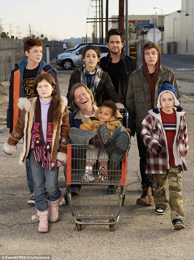Hit: Macy, 66, stars as drug and alcohol addict Frank Gallagher and Rossum is the eldest daughter who steps up to take care of her five siblings