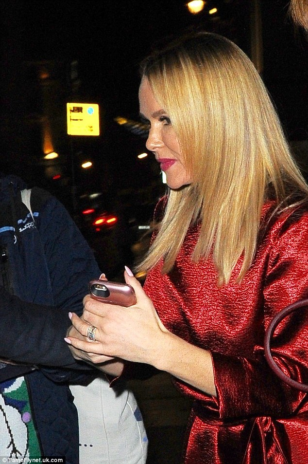 Clutching her phone: She was holding tightly to her phone on the way out