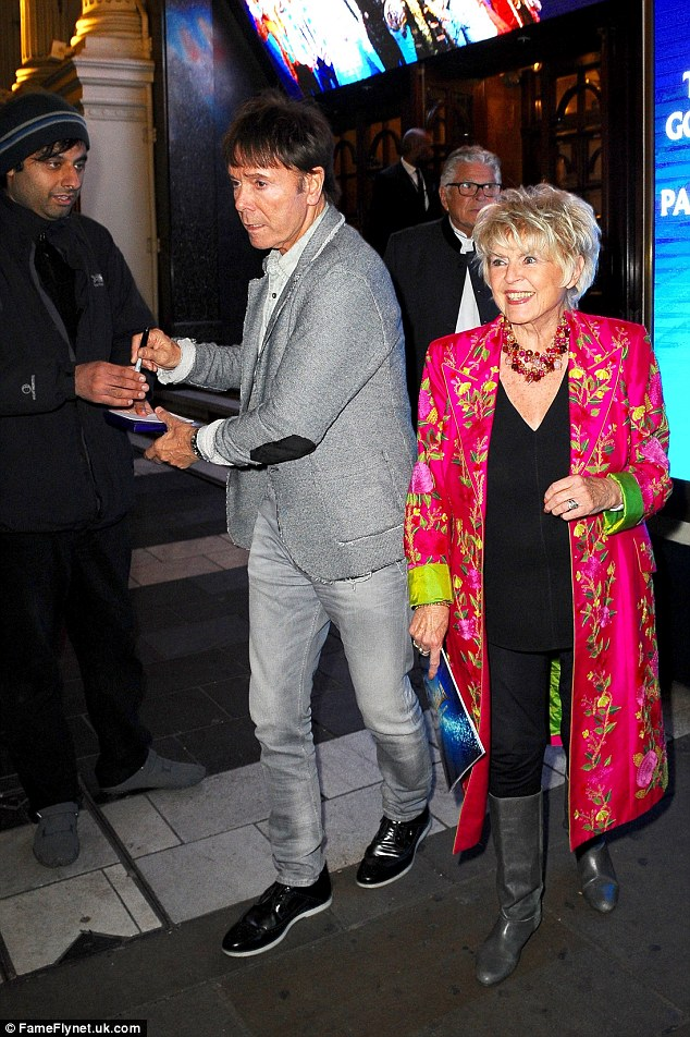 Signing autographs: Cliff Richard was seen exiting with Gloria Hunniford