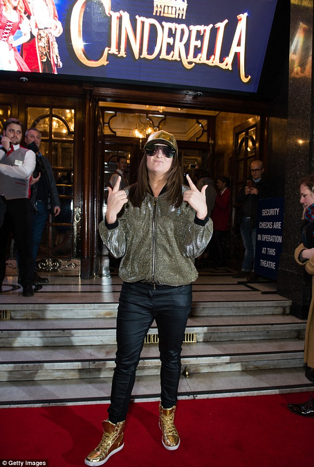All that glitters: Honey G put on her best glittery cap bomber jacket, shoes and a cap for the occasion