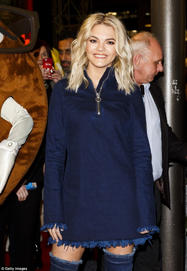 Launching it! Louisa Johnson spoke ahead of the launch of a giant M&M's wall at the refresh of M&M's World in Leicester Square on Wednesday, where she looked sensational in a chic double denim ensemble
