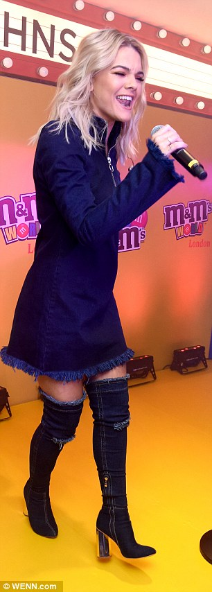 Giving the boot: Louisa showed off her slender legs in the chic getup