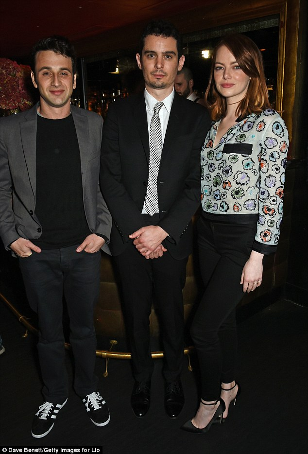 Three of a kind: Justin Hurwitz and Damien Chazelle also posed for snaps with Emma