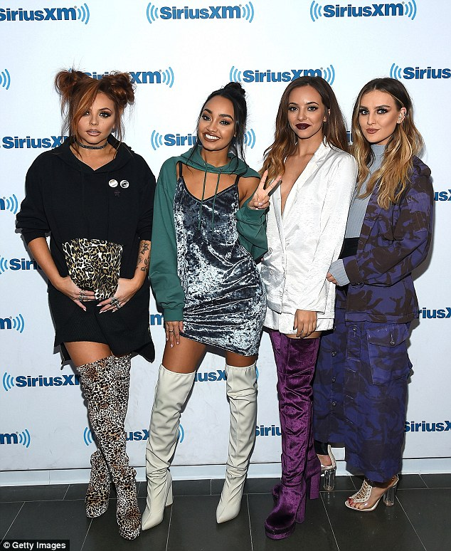 Moving on: They've come under fire  for their skimpy stage ensembles. But Little Mix  put the controversy behind them as they headed into the SiriusXM Studios in New York on Wednesday
