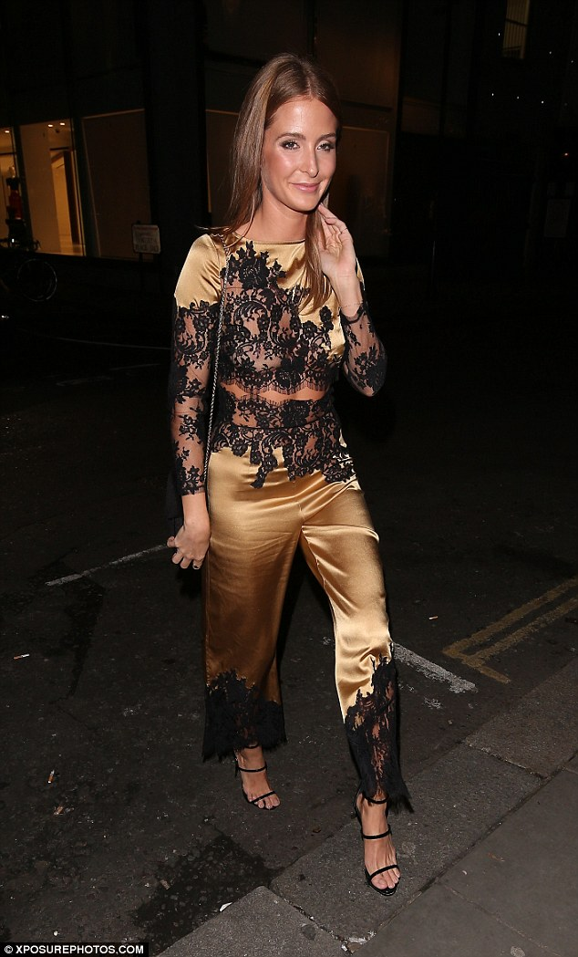 Going for gold: Millie Mackintosh was celebrating the launch of the Wonderland winter issue at Bo Lang in London on Wednesday night