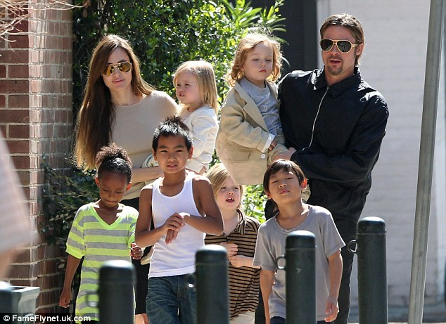 Big brood: Pitt, 52, has been requesting more visitation with the six children but per a temporary agreement, therapists must approve extra visits. The family is pictured in 2011
