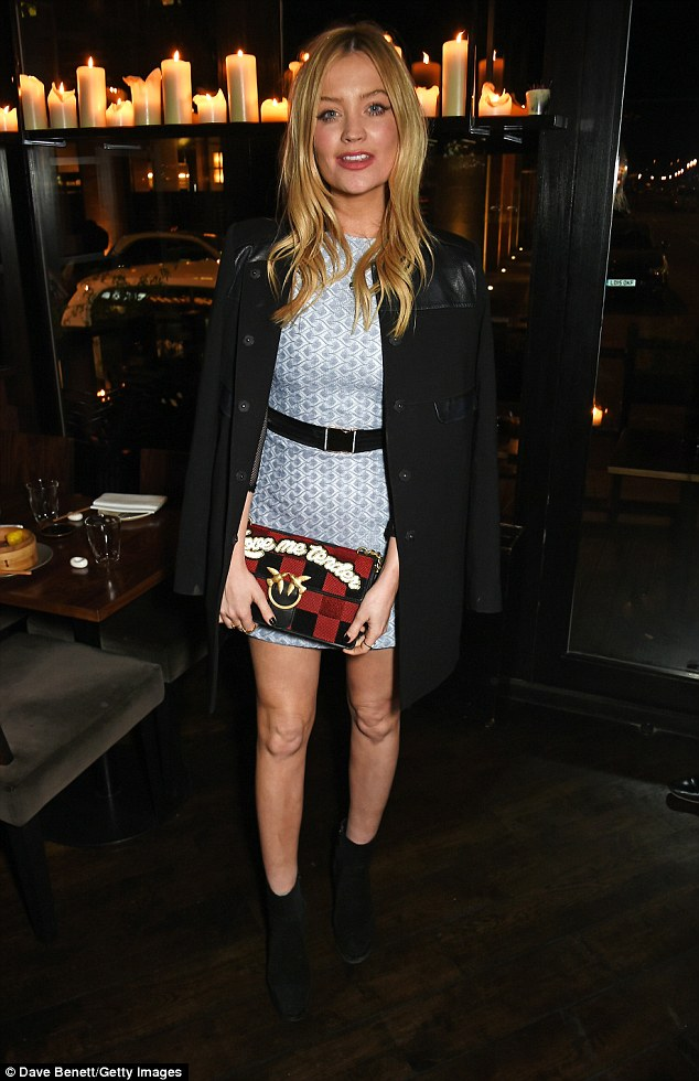 Out of the blue: Laura Whitmore, 31, was quick to show off her sartorial flair  on Wednesday night as she attended the VIP launch of the Wonderland winter issue