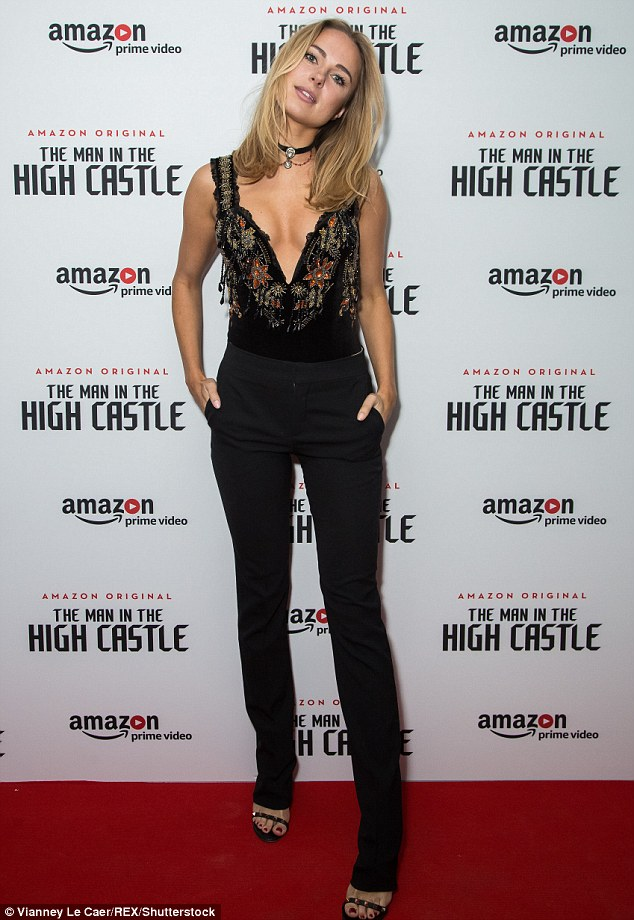 Legs for days: The former Made in Chelsea star extended her slender frame in sleek coal trousers and sparkling raven open toed heels