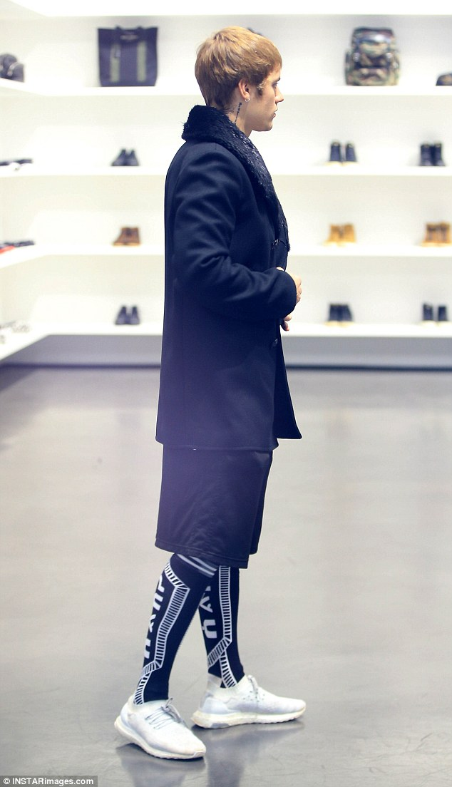 Thinking it over: Justin mulls over a purchase at Yves Saint Laurent