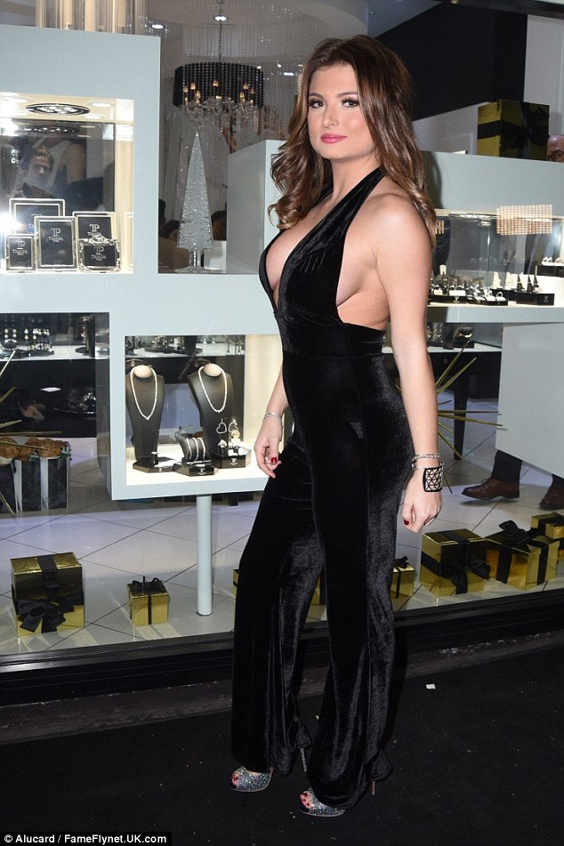 Dare to bare: The former pageant queen displayed her sensational womanly curves as she went braless in the plunging and backless velvet number