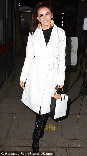 Winter warmth: Lydia layered a bold white coat on top to complete her monochrome look