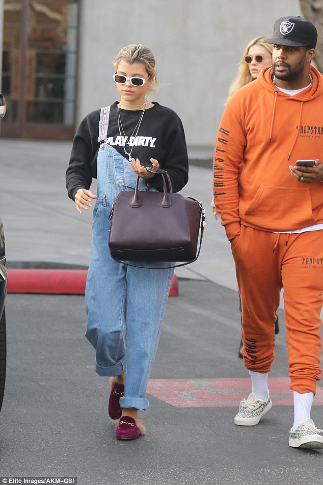 Her crew: Richie and Peltz were joined by a pal, who wore orange sweats as well