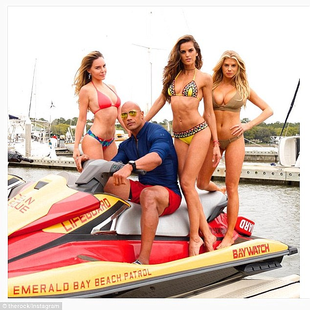 Sizzling: Next year, the Orlando native (right) will be appearing in a film adaptation of the programme Baywatch alongside Dwayne Johnson (second from left), Belinda (left) and Izabel Goulart (second from right)