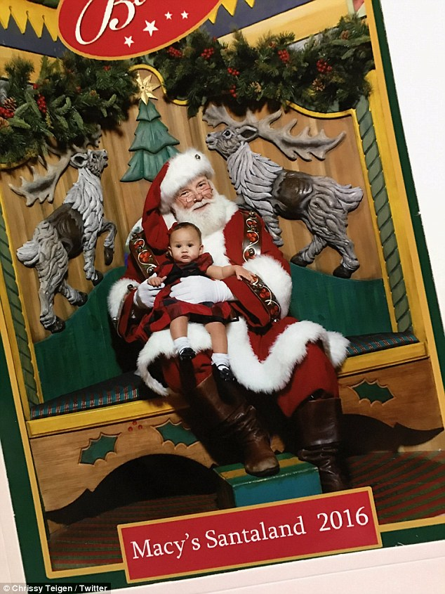 So cute:She also shared a perfect holiday portrait of Luna sitting in Santa's lap, which she described, 'my heart!! @Macys has the sweetest Santa ever'