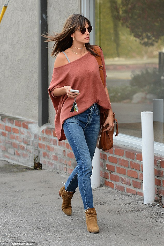 She's got style: Alessandra Ambrosio was spotted out in West Hollywood on Wednesday, looking every bit the trendsetter in her off-the-shoulder blouse and blue jeans