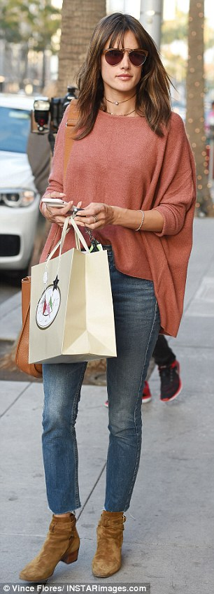 Retail therapy: The mother-of-two splashed some cash on some new goods while shopping on Rodeo Drive in Beverly Hills