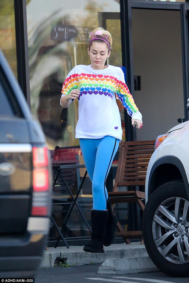 Colourful: Miley Cyrus emblazoned her heart on her sleeve on Wednesday in Los Angeles
