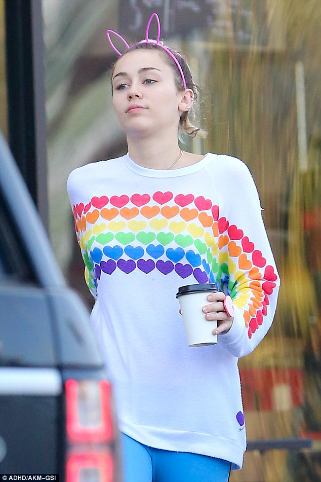 Rainbow: The 24-year-old singer  picked up a caffeine fix from a coffee shop in Los Angeles, looking colourful