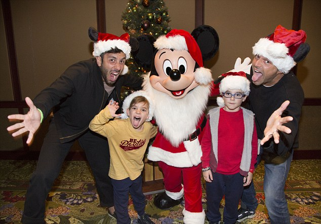 Hamming it up! Ricky Martin meets Mickey Mouse with his twin 8-year-old sons Matteo and Valentino and fiancé Jwan Yosef at the Disneyland Resort in Anaheim, California on Tuesday
