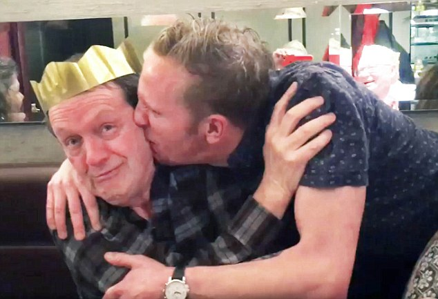 Fox, 38, shared a video online this week, in which he leans over to embrace and kiss Whately during a festive dinner party