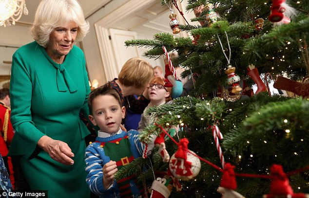 The children were helping Camilla to decorate her Christmas tree in her royal abode