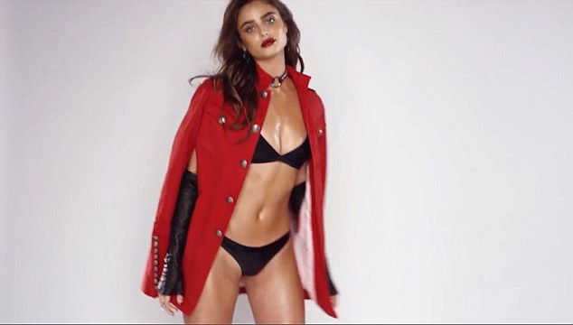 Glitter girl: The beauty - who sparkles thanks to a red glitter lip - preens and poses in her lingerie before seductively slipping on and off a red jacket