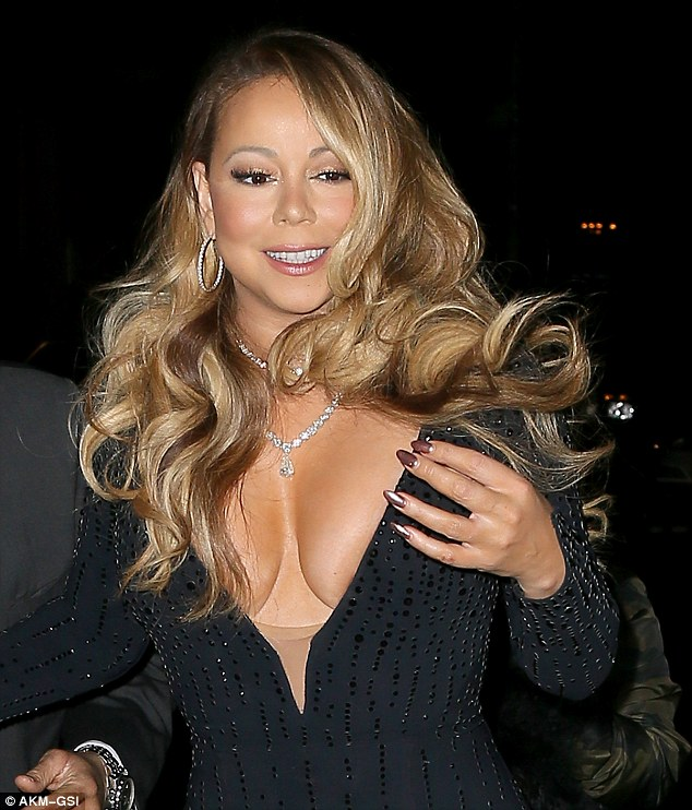 Near nip slip: The songstress's plunging neckline almost revealed rather more than she planned