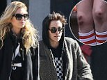 Exclusive... 52258314 Actress Kristen Stewart and her model girlfriend Stella Maxwell are spotted out and about in Savannah, Georgia on December 14, 2016. Kristen was sporting scraped up knees and a bruised face while the two were spotted out together. Earlier in the day Kristen wore shorts and made no attempt to hide the cuts and scrapes. Stella, on the other hand, did not show any signs of bruising or injuries. **NO USE W/O PRIOR AGREEMENT - CALL FOR PRICING*** FameFlynet, Inc - Beverly Hills, CA, USA - +1 (310) 505-9876