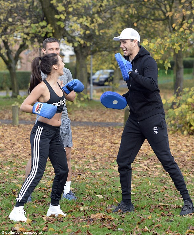 Fighting fit: She didn't look to be feeling the chilly conditions, laughing and joking in her sportswear