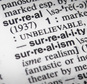 """This Saturday Dec. 17, 2016 photo shows the """"surreal"""" entry in a Merriam-Webster's dictionary in New York. """"Surreal"""" is Merriam-Webster's word of 2016 based on spikes in lookups. (AP Photo/Bebeto Matthews)"""