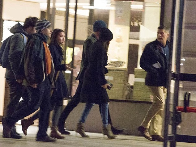 It is the first time the couple, pictured centre, have been caught on camera together in public