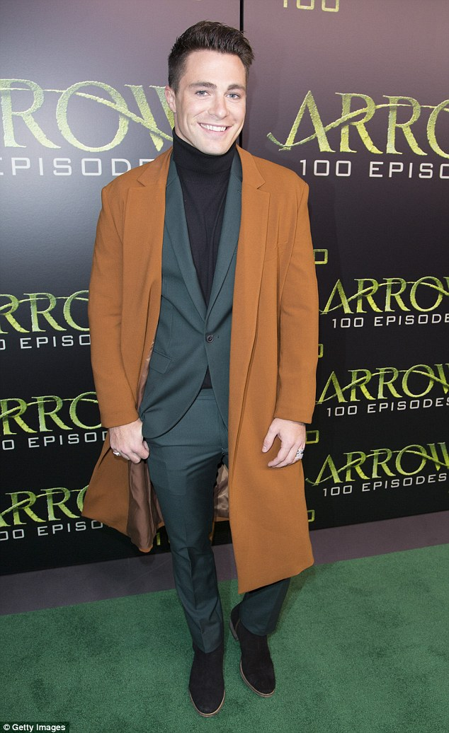 Smiling again: Former Teen Wolf star is 'the happiest' he's ever been. He attended the Holland Celebration for Arrow's 100th episode in Vancouver last October