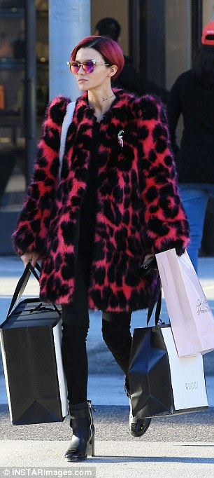 Christmas gifts for Jess? The star loaded up on her shopping spree, carrying bags from Gucci