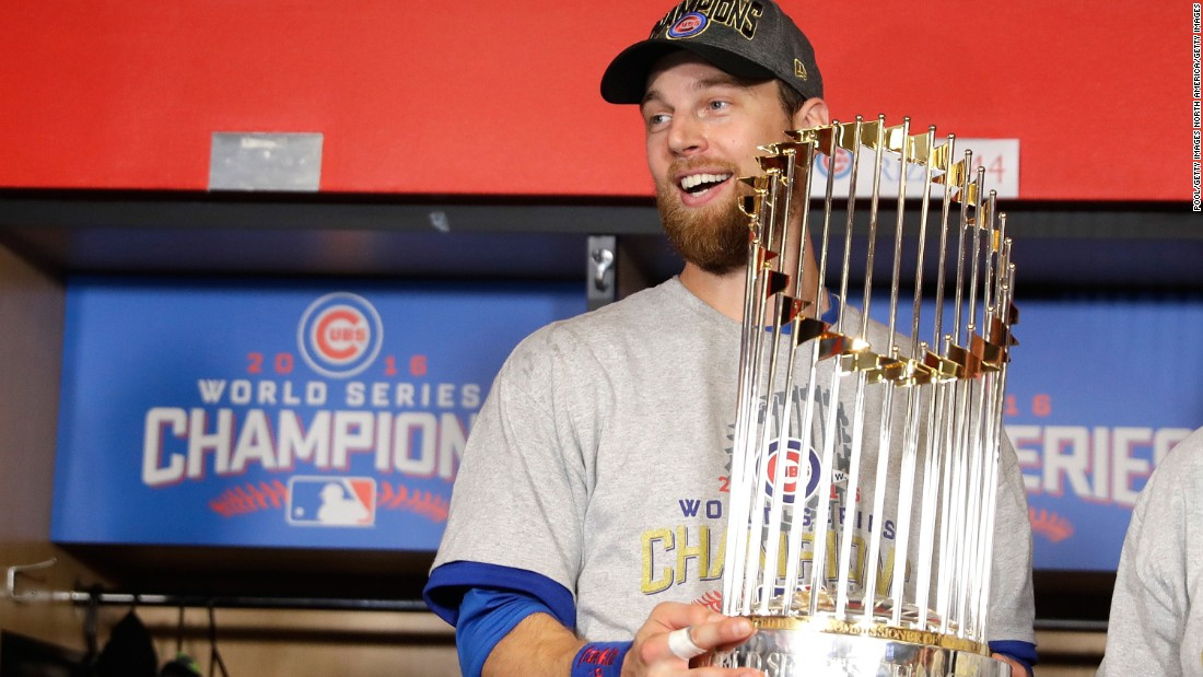 World Series MVP Ben Zobrist of the Cubs poses with The Commissioner's Trophy after Chicago defeated Cleveland 8-7 in Game 7.