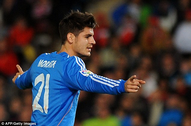 On target: Real Madrid striker Alvaro Morata celebrates after scoring against Almeria on Saturday