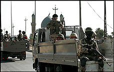 Iraqi troops patrol the streets of Diwaniyah hours after U.S. and Iraqi forces clashed with the Mahdi Army of anti-American cleric Moqtada al-Sadr. The battles reportedly did not result in any American or Iraqi army casualties.