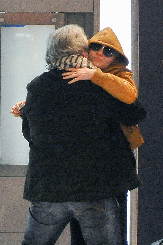 Reunited:Carrying a large holdall bag Lily hugged her grandfather happily on her arrival
