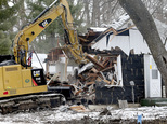 Crew demolish a small house that once belonged to Danny Heinrich, Jacob Wetterling's killer, Friday, Dec. 23, 2016, in Annandale, Minn. Real estate developer Tim Thorne bought the former home of Danny Heinrich specifically to destroy it. The empty house was a distressing reminder to the central Minnesota community that the man who killed 11-year-old Jacob in 1989 had lived among them. (Elizabeth Flores/Star Tribune via AP)