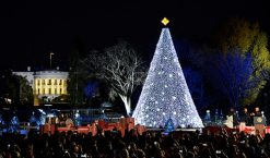 President Barack Obama (R) applauds beside members of the First Family as they participate in the 94th Annual National Christmas Tree Lighting on The Ellipse, near the White House, in Washington, U.S., December 1, 2016. REUTERS/Mike Theiler