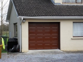 Before After Images of Restoration of Residential Garage Doors