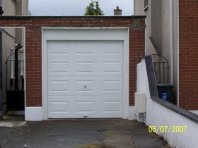 Before After Images of Restoration of Small Residential Garage Doors