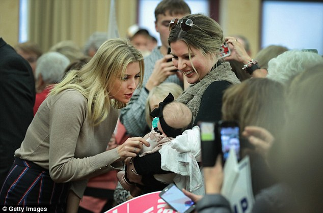 Supporting her dad: Ivanka is pictured greeting a young fan during the campaign stop