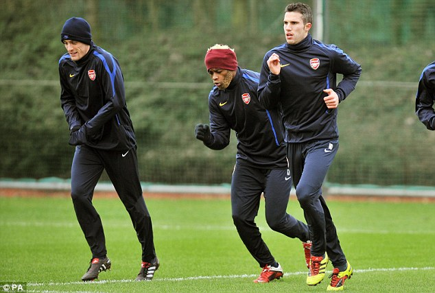 Running men: Sebastian Squillaci, Alex Song and Robin van Persie are put through their paces