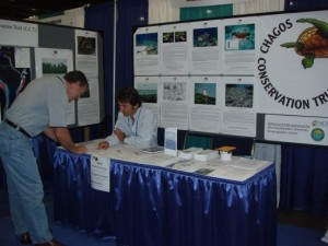 Sam Purkis signs up one of the first members of the CCT-US at the 11th ICRS in Ft. Lauderdale, Florida, 2008